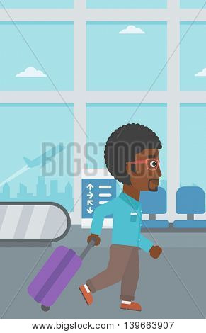 An african-american young man with a suitcase walking at the airport. Vector flat design illustration. Vertical layout.