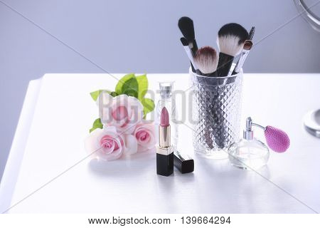 Cosmetic set on white dressing table