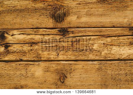 Wet wooden floor board surface of solid rustic wood planks