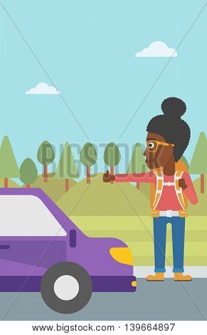 An african-american young woman with backpack hitchhiking on roadside. Hitchhiking woman trying to stop a car on the road. Vector flat design illustration. Vertical layout.