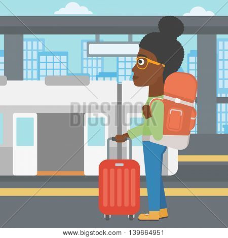 An african-american woman standing at the train station on the background of train with open doors. Young woman with suitcase waiting for a train. Vector flat design illustration. Square layout.