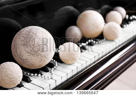 Christmas decoration on piano keys, closeup