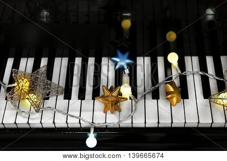 Piano keys with Christmas decorations