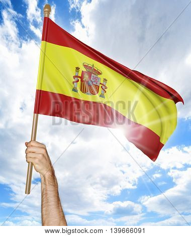 Person's hand holding the Spanish national flag and waving it in the sky, 3D rendering