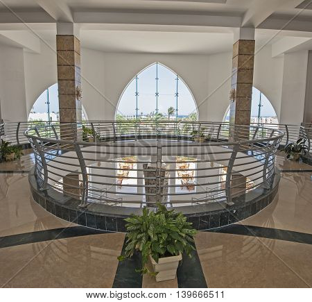 Interior design architecture of atrium lobby area in luxury tropical resort hotel with large panoramic window