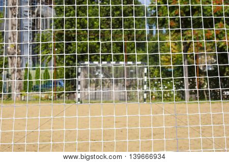 Beach soccer football goal through the net. Rio games.