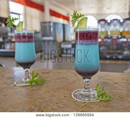 Pair Of Blue Cocktail Dirnks On A Bar