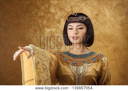 Woman pointing finger. Glamorous closeup portrait of beautiful stylish brunette young model. Power orders