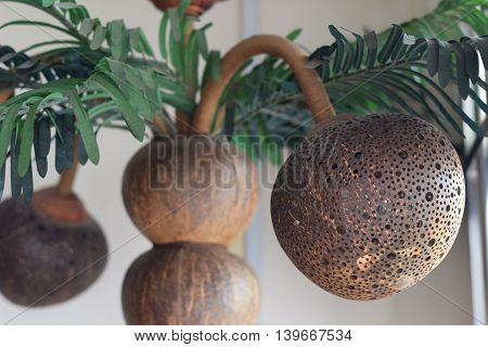 Delicate Handicrafted lamp made of coconut shell
