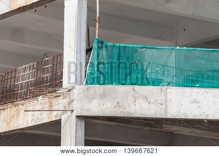 Construction site view of crane, lift, metal beam, brick, metal ladder and concrete