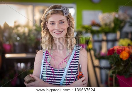 Portrait of female florist smiling in the flower shop