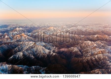 Beautiful View From The Aircraft To The Mountains In Tashkent, China And Kirgistan, Covered With Sno