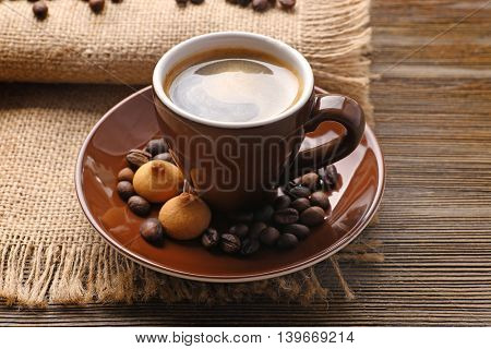 Cup of coffee on sackcloth