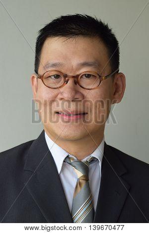 An asian man in business suit portrait