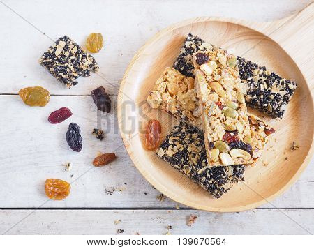 Healthy granola. Organic munchies bars on wooden background.