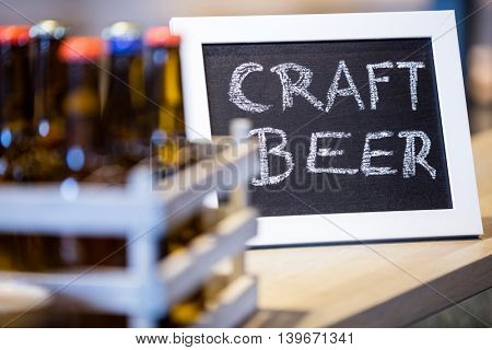 Craft beer written on slate at bar