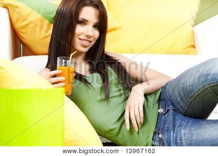 young beautiful woman with glass of juice