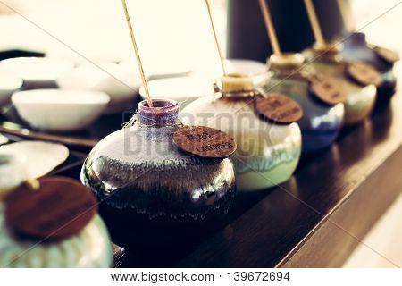 Aromatic oil in ceramic vases for traditional thai massage