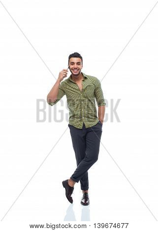 Casual business man happy smile young handsome guy cell smart phone speak full length wear shirt isolated white background