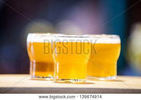 Close-up of three beer glasses on the bar counter at reasturant