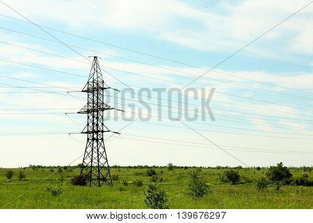 High voltage tower in field