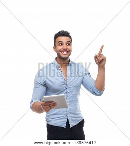Handsome business man happy smile, businessman holding tablet computer point finger to copy space, wear blue shirt isolated over white background