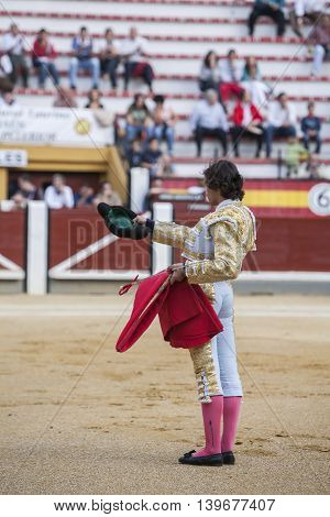 Jaen SPAIN - October 17 2008: The Spanish Bullfighter Curro Diaz greeting the public with its cap in the hand in gratitude to its bullfight in the Bullring of Jaen Spain