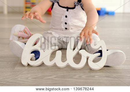 Baby sitting with decoration in room