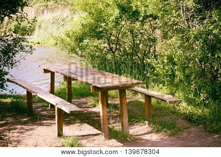 Bench and table in a tranquil landscape
