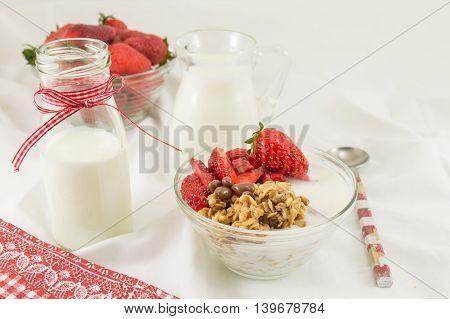Granola Cereals, Fresh Strawberries And Bottle Of Milk