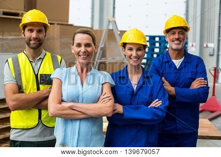 Workers team crossing arms in warehouse