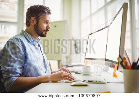 Young businessman working in creative office