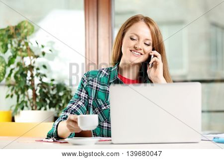 Creative girl working with laptop in office