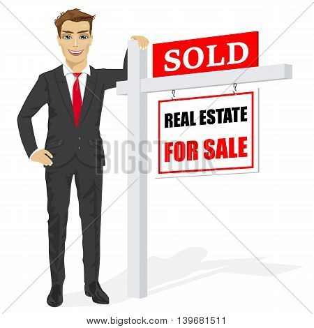 Male real estate agent standing next to a sold for sale sign on white background