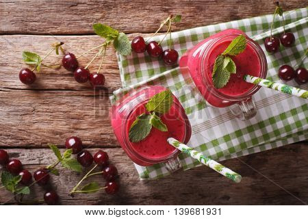 Healthy Cherry Cocktail With Mint In Glass Jars Close-up. Horizontal Top View