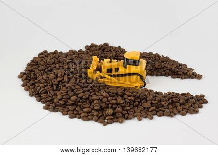 small yellow industrial vehicles work with coffee beans