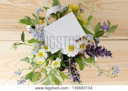 bouquet of wild flowers with a card top view