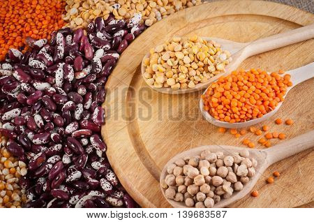 multicolored slides beans peas chickpeas and corn in a spoon