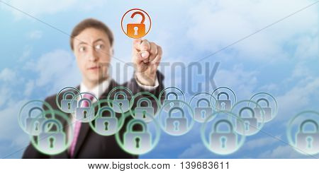 Manager is looking at a virtual padlock he is opening by touch in midair. Concept for data security access control cloud computing information technology governance and data resource management.