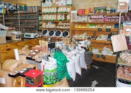FREMANTLE,WA,AUSTRALIA-JUNE 25,2016: Fremantle Markets with organic market stall with bags of beans, and shelves of wholesome products in Fremantle, Western Australia.