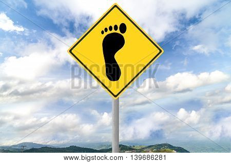 Footprint sign on traffic sign with blue sky