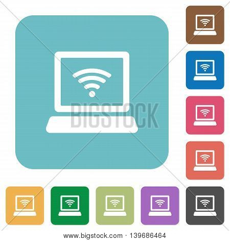 Flat computer with wireless icons on rounded square color backgrounds.