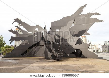 BARCELONA, SPAIN - MAY 09, 2016 :  Espanya Industrial Park with giant metal sculpture of dragon.It is located near Sants train station, an area of 4.6 hectares is ideal for family relaxation. A special highlight is a giant dragon - slide for children.