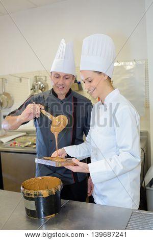 chefs preparing caramel sauce