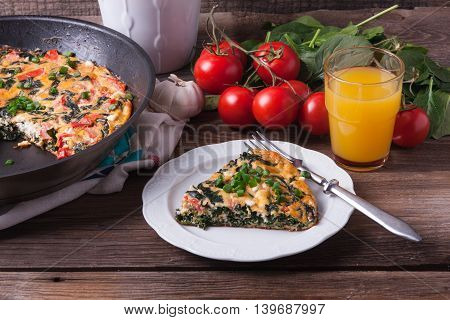 Frittata With Spinach, Tomatoes And Cheese
