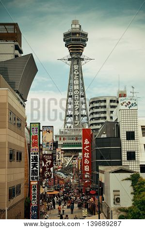 OSAKA, JAPAN - MAY 11: Tsutenkaku with street as famous landmark on May 11, 2013 in Osaka. With nearly 19 million inhabitants, Osaka is the second largest metropolitan area in Japan after Tokyo.