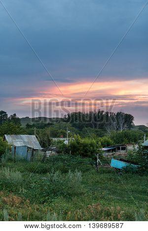 Bright sunset sky over a summer rural landscape