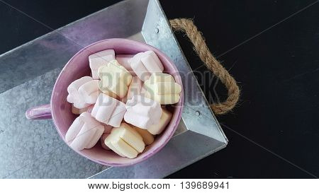 flower shape marshmallow candies on a tray