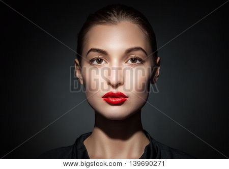Portrait of attractive model with red lips looking calmly at camera.Studio shot.Isolate