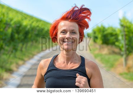 Smiling Happy Woman Jogging In A Vineyard